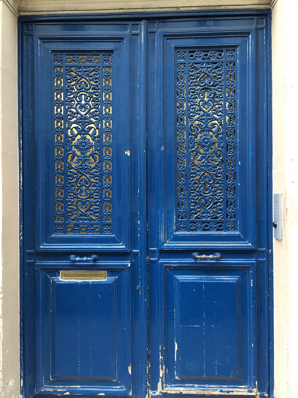 Ornate lacework blue door