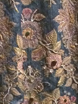 Closeup of embroidery on floor.length jacket