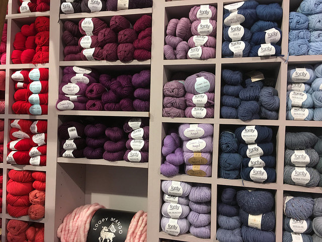 Yarn organized by color at Lil Weasel