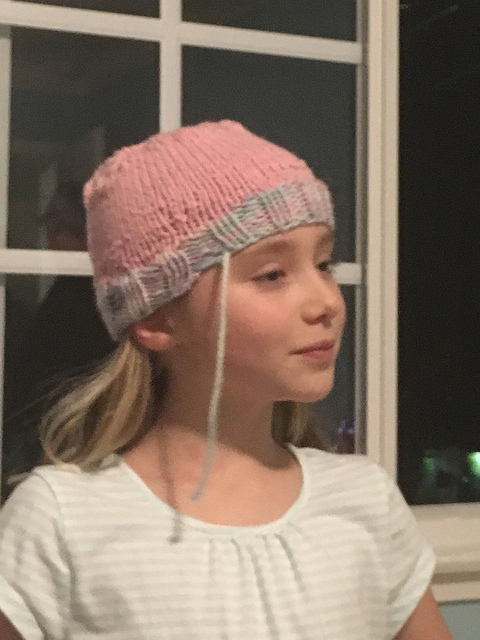 Tali learning to knit her hat