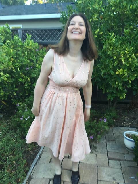 Peaches dress laughing